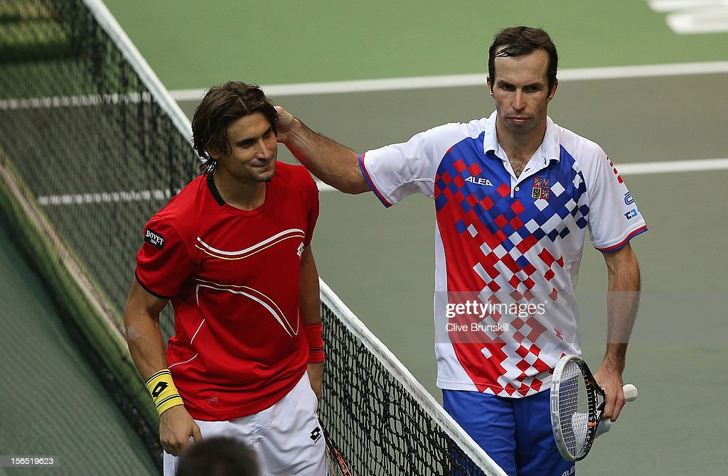 <a gi-track='captionPersonalityLinkClicked' href=/galleries/search?phrase=David+Ferrer&family=editorial&specificpeople=208197 ng-click='$event.stopPropagation()'>David Ferrer</a> of Spain is congratulated at the net after his straight sets victory in the first rubber against <a gi-track='captionPersonalityLinkClicked' href=/galleries/search?phrase=Radek+Stepanek&family=editorial&specificpeople=193842 ng-click='$event.stopPropagation()'>Radek Stepanek</a> of Czech Republic during day one of the final Davis Cup match between Czech Republic and Spain at the 02 Arena on November 16, 2012 in Prague, Czech Republic.