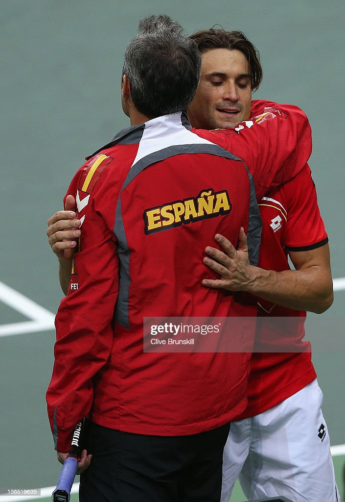 <a gi-track='captionPersonalityLinkClicked' href=/galleries/search?phrase=David+Ferrer&family=editorial&specificpeople=208197 ng-click='$event.stopPropagation()'>David Ferrer</a> of Spain is congratulated by his team captain <a gi-track='captionPersonalityLinkClicked' href=/galleries/search?phrase=Alex+Corretja&family=editorial&specificpeople=211620 ng-click='$event.stopPropagation()'>Alex Corretja</a> after his straight sets victory in the first rubber against Radek Stepanek of Czech Republic during day one of the final Davis Cup match between Czech Republic and Spain at the 02 Arena on November 16, 2012 in Prague, Czech Republic.