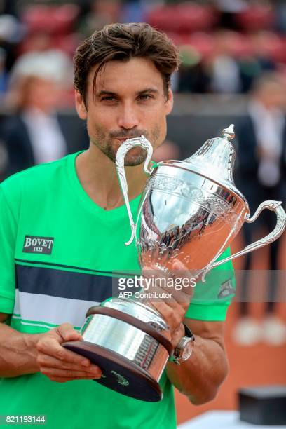 David Ferrer of Spain kisses his trophy after winning the singles final match of the Swedish Open ATP tennis tournament against Alexandr Dolgopolov...