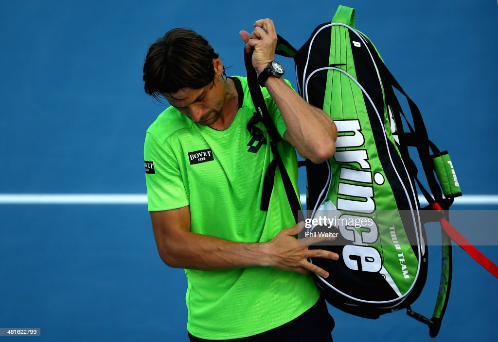 <a gi-track='captionPersonalityLinkClicked' href=/galleries/search?phrase=David+Ferrer&family=editorial&specificpeople=208197 ng-click='$event.stopPropagation()'>David Ferrer</a> of Spain leaves the court following his semi final loss to Yen-Hsun Lu of Chinese Tapei during day five of the Heineken Open at the ASB Tennis Centre on January 10, 2014 in Auckland, New Zealand.