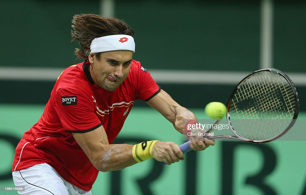 <a gi-track='captionPersonalityLinkClicked' href=/galleries/search?phrase=David+Ferrer&family=editorial&specificpeople=208197 ng-click='$event.stopPropagation()'>David Ferrer</a> of Spain plays a backhand against Radek Stepanek of Czech Republic during day one of the final Davis Cup match between Czech Republic and Spain at the 02 Arena on November 16, 2012 in Prague, Czech Republic.