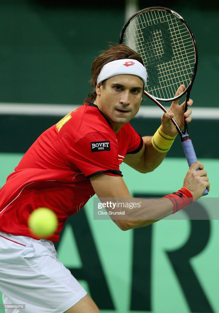 <a gi-track='captionPersonalityLinkClicked' href=/galleries/search?phrase=David+Ferrer&family=editorial&specificpeople=208197 ng-click='$event.stopPropagation()'>David Ferrer</a> of Spain plays a backhand against Tomas Berdych of Czech Republic during day three of the final Davis Cup match between Czech Republic and Spain at the 02 Arena on November 18, 2012 in Prague, Czech Republic.