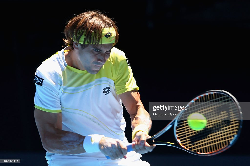 David Ferrer of Spain plays a backhand in his Quarterfinal match against Nicolas Almagro of Spain during day nine of the 2013 Australian Open at Melbourne Park on January 22, 2013 in Melbourne, Australia.