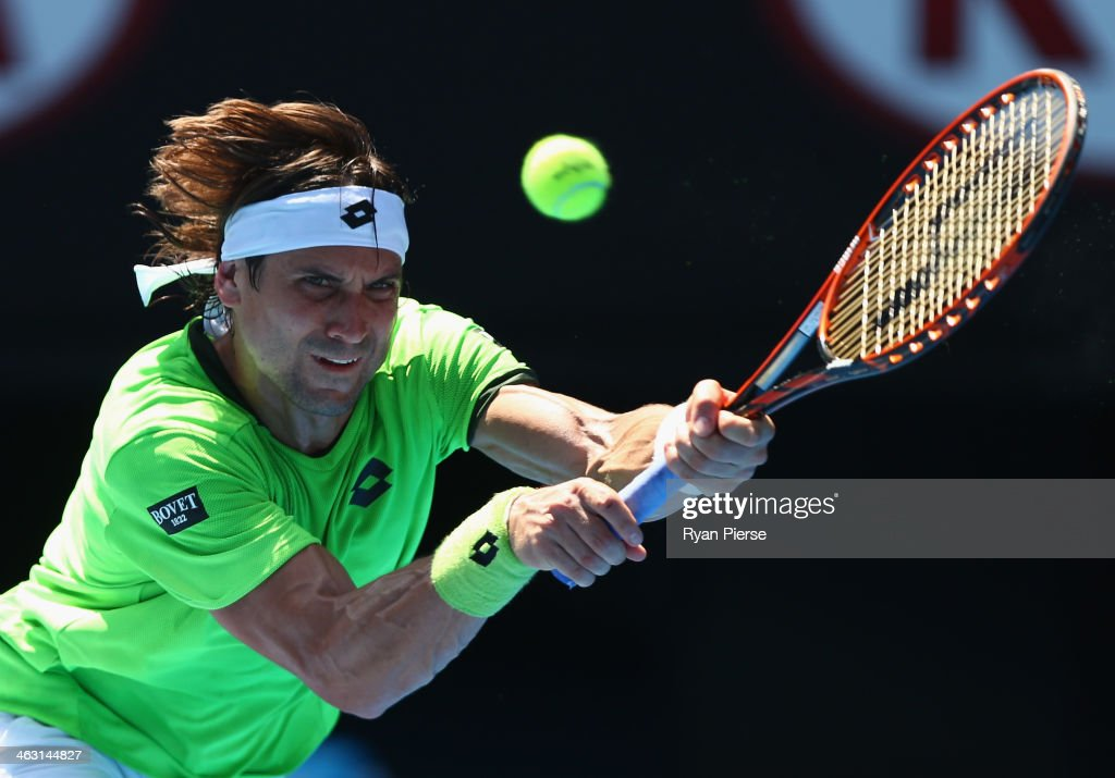 <a gi-track='captionPersonalityLinkClicked' href=/galleries/search?phrase=David+Ferrer&family=editorial&specificpeople=208197 ng-click='$event.stopPropagation()'>David Ferrer</a> of Spain plays a backhand in his third round match against Jeremy Chardy of France during day five of the 2014 Australian Open at Melbourne Park on January 17, 2014 in Melbourne, Australia.
