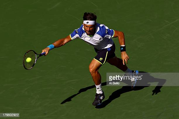 David Ferrer of Spain plays a forehand during his men's singles quarterfinal match against Richard Gasquet of France on Day Ten of the 2013 US Open...