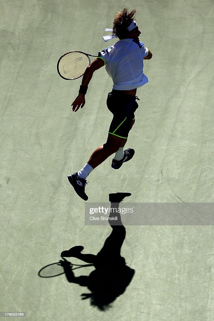<a gi-track='captionPersonalityLinkClicked' href=/galleries/search?phrase=David+Ferrer&family=editorial&specificpeople=208197 ng-click='$event.stopPropagation()'>David Ferrer</a> of Spain plays a forehand during his men's singles quarter-final match against Richard Gasquet of France on Day Ten of the 2013 US Open at USTA Billie Jean King National Tennis Center on September 4, 2013 in the Flushing neighborhood of the Queens borough of New York City.