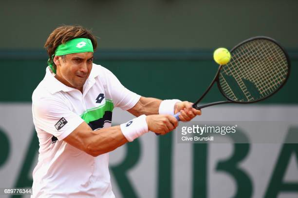 David Ferrer of Spain plays a forehand during the mens singles first round match against Donald Young of The United States on day two of the 2017...