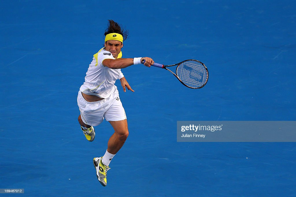 David Ferrer of Spain plays a forehand in his first round match against Olivier Rochus of Belgium during day one of the 2013 Australian Open at Melbourne Park on January 14, 2013 in Melbourne, Australia.