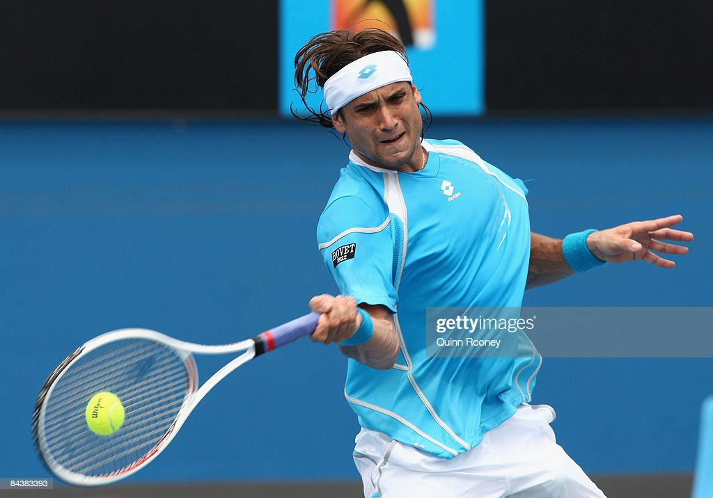 David Ferrer of Spain plays a forehand in his second round match against Dominik Hrbaty of Slovakia during day three of the 2009 Australian Open at Melbourne Park on January 21, 2009 in Melbourne, Australia.