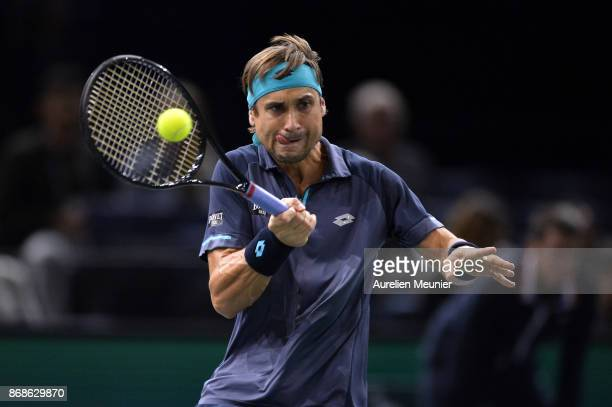 David Ferrer of Spain plays a forehand in the men's single first round match against Adrian Mannarino of France during day two of the Rolex Paris...