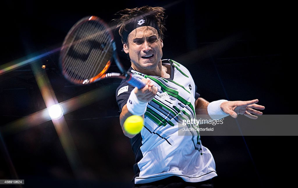 David Ferrer of Spain plays a forehand in the round robin singles match against Kei Nishikori of Japan on day five of the Barclays ATP World Tour Finals at O2 Arena on November 13, 2014 in London, England.