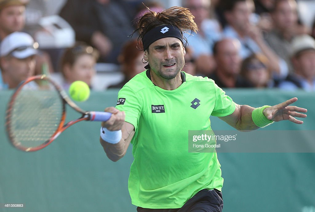 <a gi-track='captionPersonalityLinkClicked' href=/galleries/search?phrase=David+Ferrer&family=editorial&specificpeople=208197 ng-click='$event.stopPropagation()'>David Ferrer</a> of Spain plays a shot against Donald Young of USA during day three of the Heineken Open at ASB Tennis Centre on January 8, 2014 in Auckland, New Zealand.