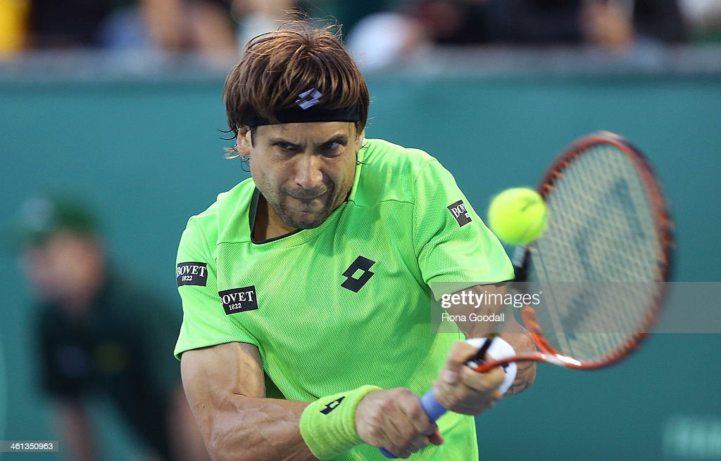 David Ferrer of Spain plays a shot against Donald Young of USA during day three of the Heineken Open at ASB Tennis Centre on January 8, 2014 in Auckland, New Zealand.