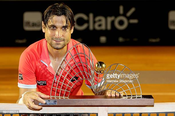 David Ferrer of Spain poses for photographers after his win over Fabio Fognini of Italy during the final of the Rio Open at the Jockey Club...