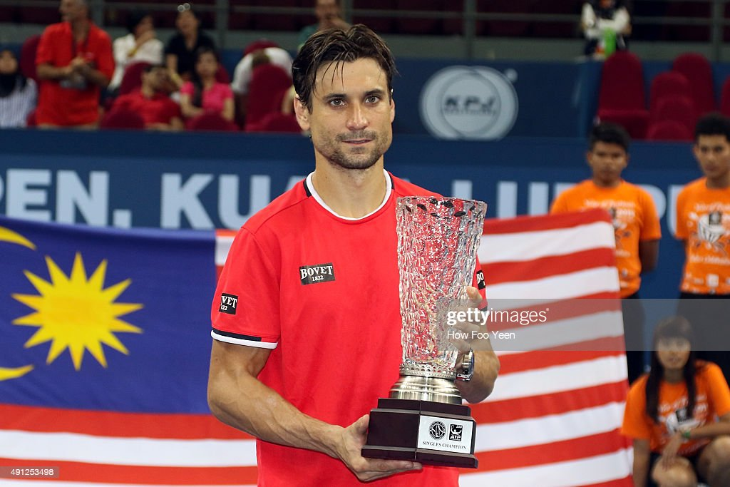 <a gi-track='captionPersonalityLinkClicked' href=/galleries/search?phrase=David+Ferrer&family=editorial&specificpeople=208197 ng-click='$event.stopPropagation()'>David Ferrer</a> of Spain poses with his trophy after defeating Feliciano Lopez of Spain 7-5 7-5 in the finals during the 2015 ATP Malaysian Open at Bukit Jalil National Stadium on October 4, 2015 in Kuala Lumpur, Malaysia.