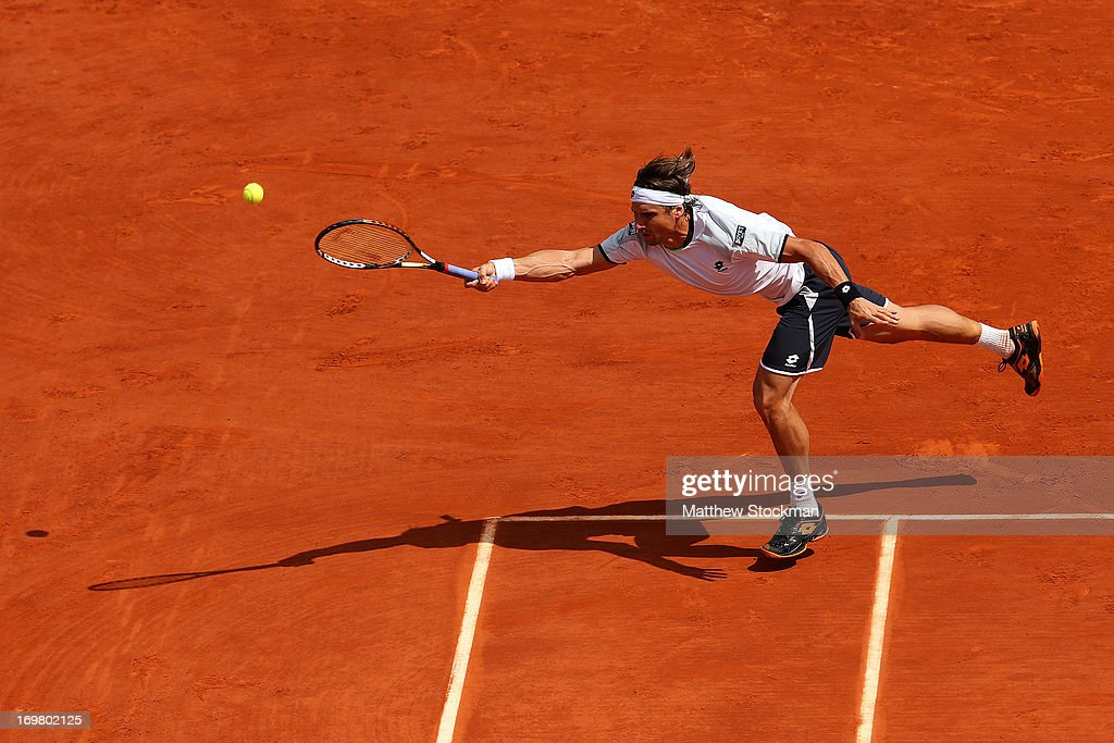 <a gi-track='captionPersonalityLinkClicked' href=/galleries/search?phrase=David+Ferrer&family=editorial&specificpeople=208197 ng-click='$event.stopPropagation()'>David Ferrer</a> of Spain reaches for a forehand in his Men's Singles match against Kevin Anderson of South Africa during day eight of the French Open at Roland Garros on June 2, 2013 in Paris, France.