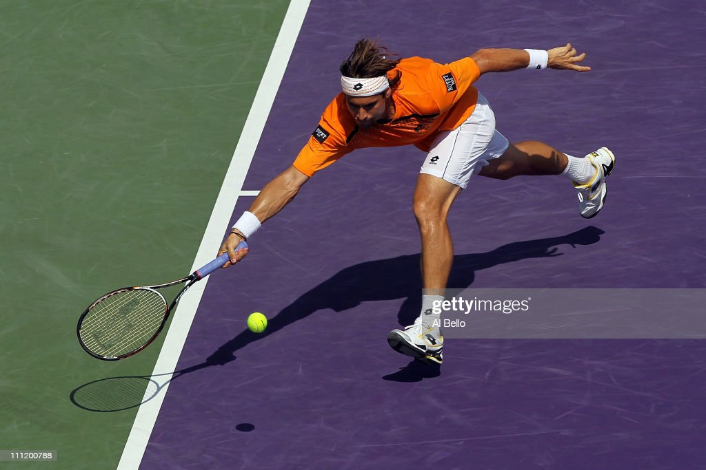 <a gi-track='captionPersonalityLinkClicked' href=/galleries/search?phrase=David+Ferrer&family=editorial&specificpeople=208197 ng-click='$event.stopPropagation()'>David Ferrer</a> of Spain reaches for a forehand return Mardy Fish during the Sony Ericsson Open at Crandon Park Tennis Center on March 30, 2011 in Key Biscayne, Florida.