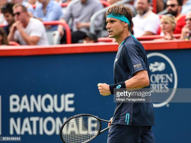 David Ferrer of Spain reacts after scoring a point against Roger Federer of Switzerland during day seven of the Rogers Cup presented by National Bank...