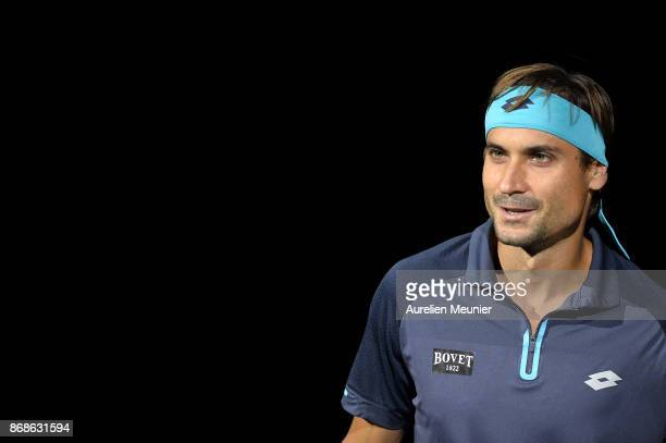 David Ferrer of Spain reacts as he arrives for his men's single first round match against Adrian Mannarino of France during day two of the Rolex...