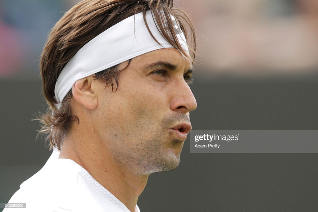 <a gi-track='captionPersonalityLinkClicked' href=/galleries/search?phrase=David+Ferrer&family=editorial&specificpeople=208197 ng-click='$event.stopPropagation()'>David Ferrer</a> of Spain reacts during the Men's Singles first round match against Dudi Sela of Israel on day one of the Wimbledon Lawn Tennis Championships at the All England Lawn Tennis and Croquet Club on June 27th, 2016 in London, England.