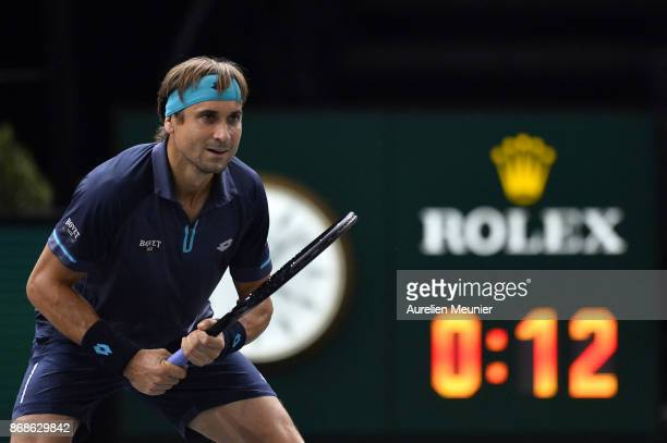 David Ferrer of Spain reacts in the men's single first round match against Adrian Mannarino of France during day two of the Rolex Paris Masters at...
