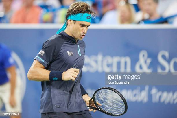 David Ferrer of Spain reacts to a point against Nick Kyrgios of Australia during their semifinal match in the Western Southern Open at the Lindner...