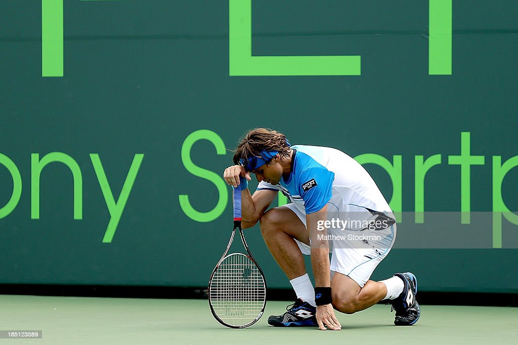 David Ferrer of Spain reacts to losing a challenge for match point against Andy Murray of Great Britain during the final of the Sony Open at Crandon Park Tennis Center on March 31, 2013 in Key Biscayne, Florida.