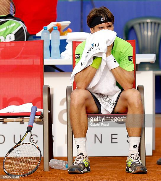 David Ferrer of Spain rests during an exhibition at Jockey Club on November 17 2013 in Lima Peru