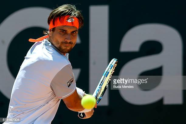 David Ferrer of Spain returns a shot to Albert RamosVinolas of Spain during the Rio Open at Jockey Club Brasileiro on February 18 2016 in Rio de...