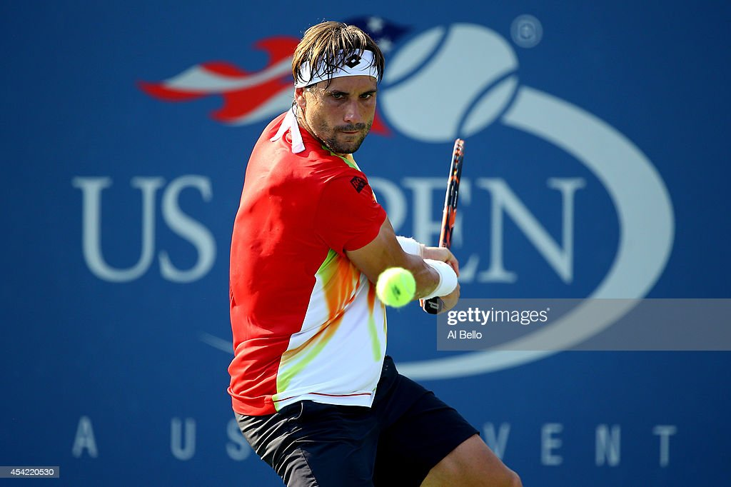 <a gi-track='captionPersonalityLinkClicked' href=/galleries/search?phrase=David+Ferrer&family=editorial&specificpeople=208197 ng-click='$event.stopPropagation()'>David Ferrer</a> of Spain returns a shot to Damir Dzumhur of Bosnia and Herzegovina during his men's singles first round match on Day Two of the 2014 US Open at the USTA Billie Jean King National Tennis Center on August 26, 2014 in the Flushing neighborhood of the Queens borough of New York City.