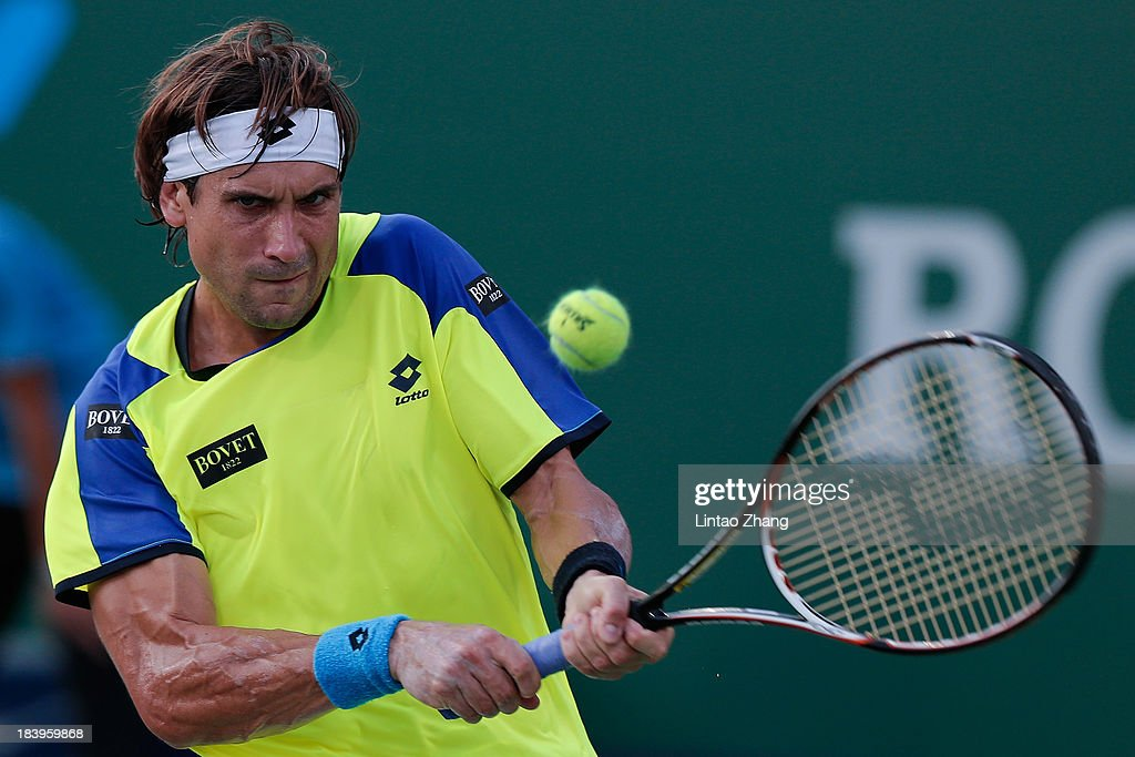 <a gi-track='captionPersonalityLinkClicked' href=/galleries/search?phrase=David+Ferrer&family=editorial&specificpeople=208197 ng-click='$event.stopPropagation()'>David Ferrer</a> of Spain returns a shot to Florian Mayer of Germany during day four of the Shanghai Rolex Masters at the Qi Zhong Tennis Center on October 9, 2013 in Shanghai, China.