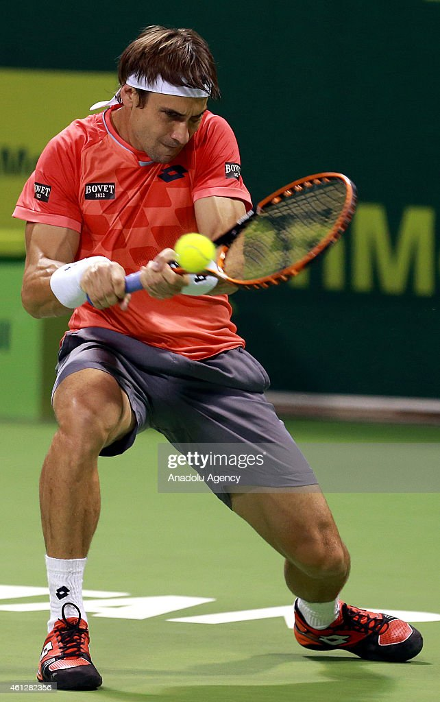 David Ferrer of Spain returns the ball to Tomas Berdych of Czech Republic during the final match of the Qatar ExxonMobil ATP Open Tennis tournament at the Khalifa Tennis Complex in Doha, Qatar on 10 January 2015.