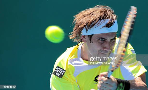 David Ferrer of Spain returns to Santiago Giraldo of Colombia during Heineken Open men's semifinals in Auckland on January 14 2011 David Ferrer won...