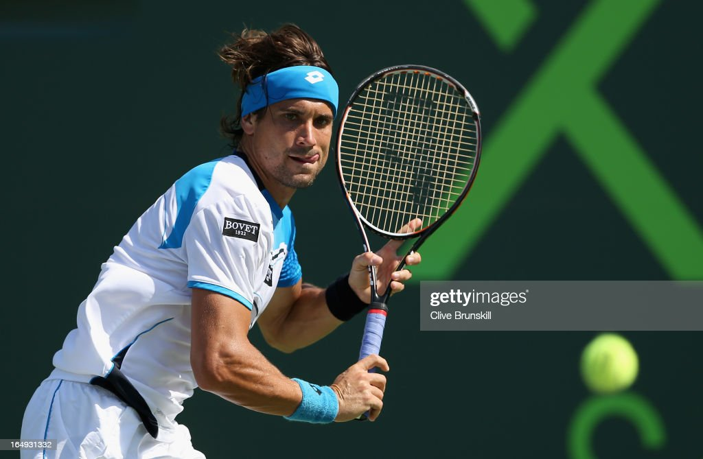 <a gi-track='captionPersonalityLinkClicked' href=/galleries/search?phrase=David+Ferrer&family=editorial&specificpeople=208197 ng-click='$event.stopPropagation()'>David Ferrer</a> of Spain runs to line up a backhand against Tommy Haas of Germany during their semi final match at the Sony Open at Crandon Park Tennis Center on March 29, 2013 in Key Biscayne, Florida.