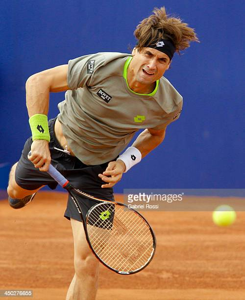 David Ferrer of Spain serves during an exhibition at Jockey Club on November 17 2013 in Lima Peru