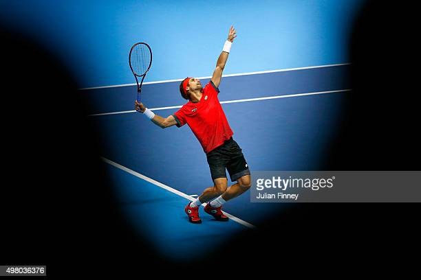 David Ferrer of Spain serves during the men's singles match against Rafael Nadal of Spain on day six of the Barclays ATP World Tour Finals at the O2...