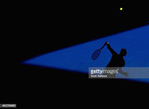 David Ferrer of Spain serves in his fourth round match against Kei Nishikori of Japan during day eight of the 2015 Australian Open at Melbourne Park...
