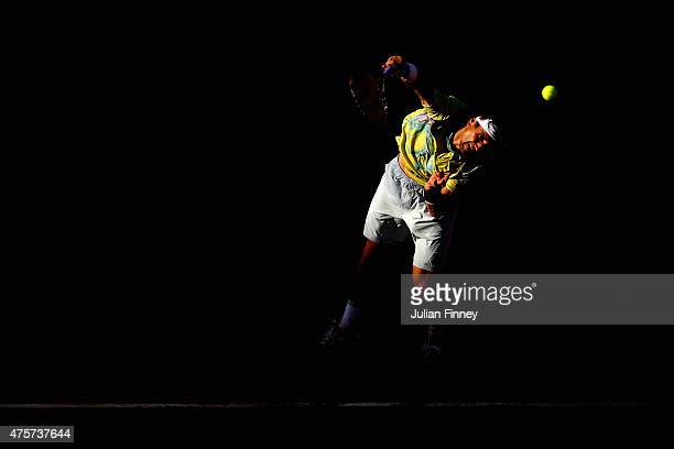 David Ferrer of Spain serves in his Men's quarter final match against Andy Murray of Great Britain on day eleven of the 2015 French Open at Roland...