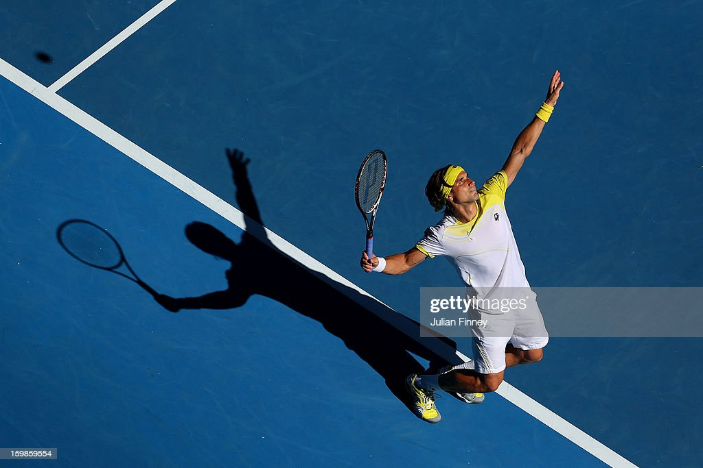 David Ferrer of Spain serves in his Quarterfinal match against Nicolas Almagro of Spain during day nine of the 2013 Australian Open at Melbourne Park on January 22, 2013 in Melbourne, Australia.