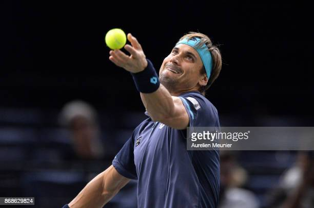 David Ferrer of Spain serves in the men's single first round match against Adrian Mannarino of France during day two of the Rolex Paris Masters at...