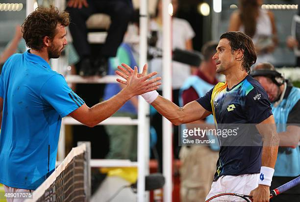 David Ferrer of Spain shakes hands at the net after his straight sets victory against Ernests Gulbis of Latvia in their quarter final match during...