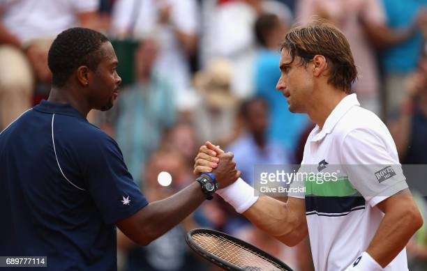 David Ferrer of Spain shakes hands with Donald Young of The United States following the mens singles first round match on day two of the 2017 French...
