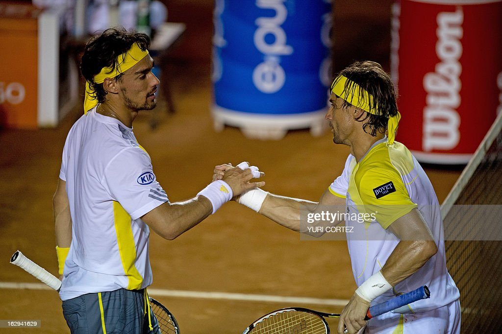 David Ferrer (R) of Spain shakes hands with Fabio Fognini of Italy after the end of their semi-final Mexico ATP Open men's single tennis match, in Acapulco, Guerrero state on March 1, 2013. AFP PHOTO/ Yuri CORTEZ