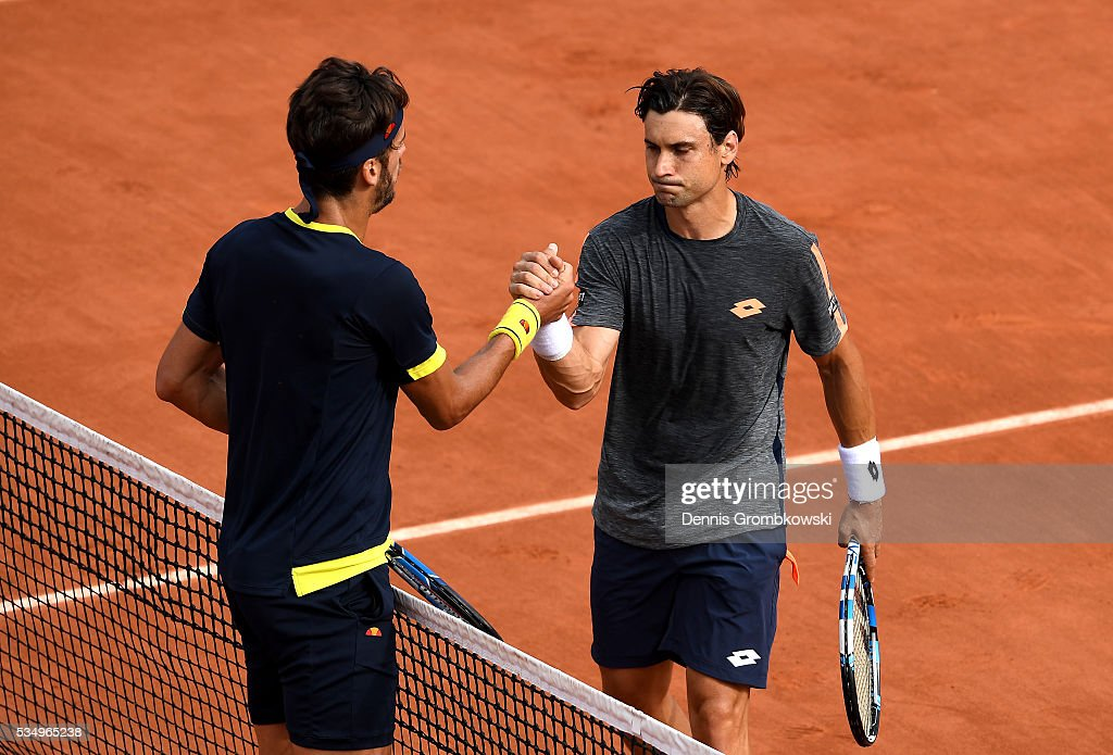 <a gi-track='captionPersonalityLinkClicked' href=/galleries/search?phrase=David+Ferrer&family=editorial&specificpeople=208197 ng-click='$event.stopPropagation()'>David Ferrer</a> (R) of Spain shakes hands with <a gi-track='captionPersonalityLinkClicked' href=/galleries/search?phrase=Feliciano+Lopez&family=editorial&specificpeople=206172 ng-click='$event.stopPropagation()'>Feliciano Lopez</a> of Spain following his victory during the Men's Singles third round match on day seven of the 2016 French Open at Roland Garros on May 28, 2016 in Paris, France.