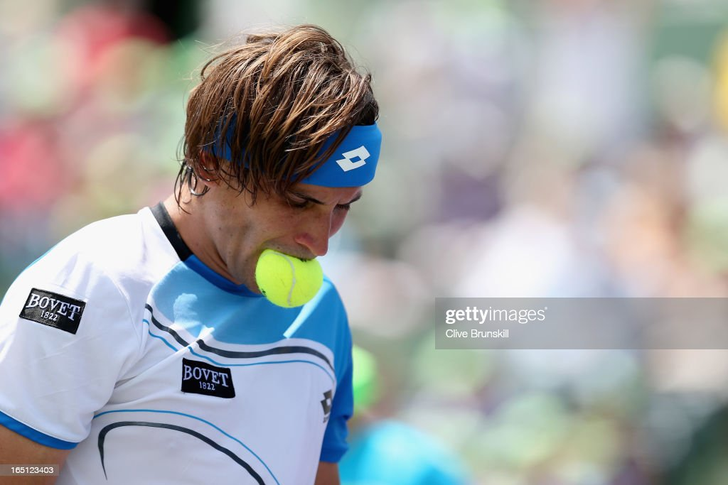 David Ferrer of Spain shows his frustrations as he bites the match ball on the way to his three set defeat by Andy Murray of Great Britain during their final match at the Sony Open at Crandon Park Tennis Center on March 31, 2013 in Key Biscayne, Florida.