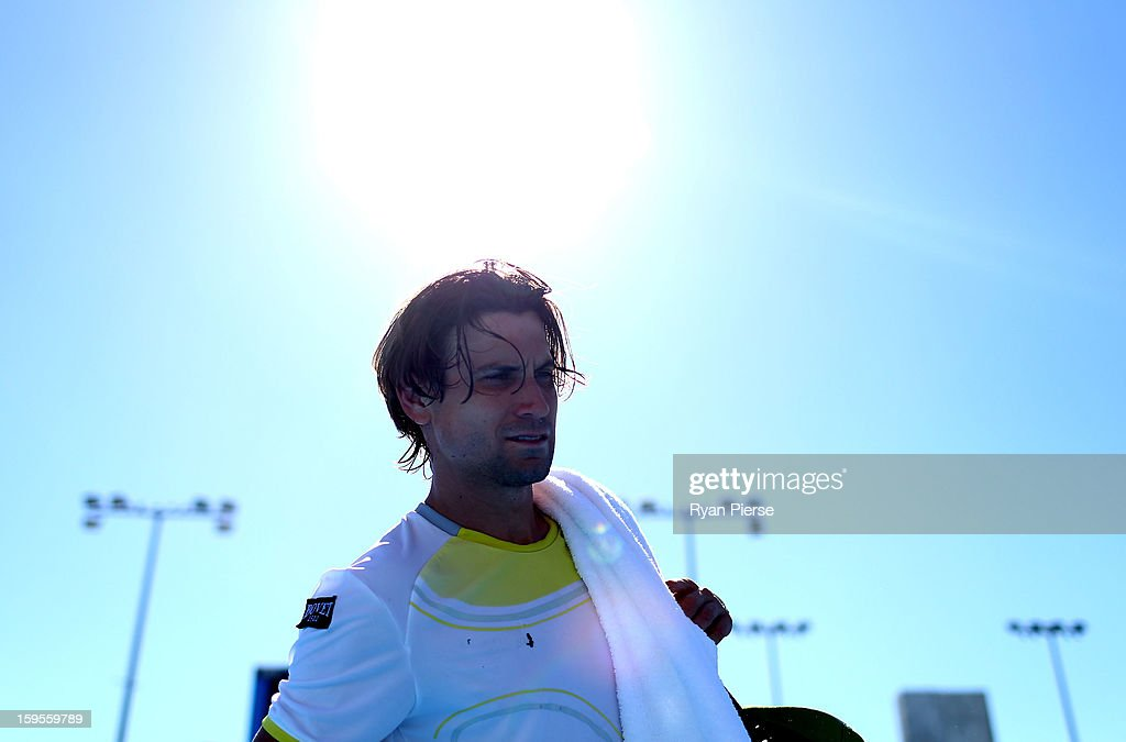 <a gi-track='captionPersonalityLinkClicked' href=/galleries/search?phrase=David+Ferrer&family=editorial&specificpeople=208197 ng-click='$event.stopPropagation()'>David Ferrer</a> of Spain walks off court after winning his second round match against Tim Smyczek of the United States during day three of the 2013 Australian Open at Melbourne Park on January 16, 2013 in Melbourne, Australia.