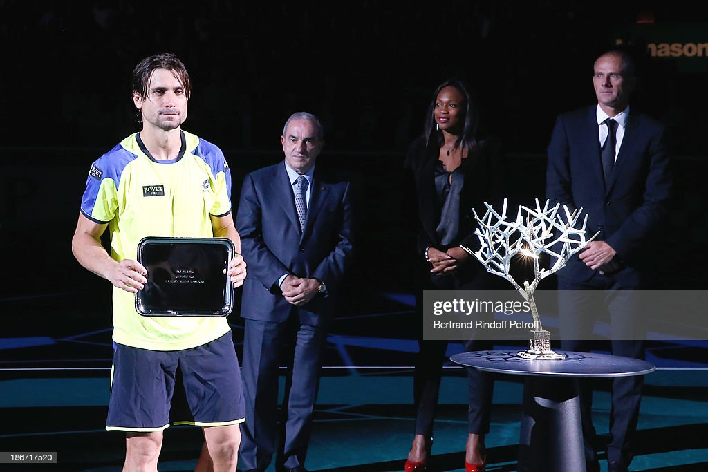 <a gi-track='captionPersonalityLinkClicked' href=/galleries/search?phrase=David+Ferrer&family=editorial&specificpeople=208197 ng-click='$event.stopPropagation()'>David Ferrer</a>, President of French Tennis Federation <a gi-track='captionPersonalityLinkClicked' href=/galleries/search?phrase=Jean+Gachassin&family=editorial&specificpeople=5701397 ng-click='$event.stopPropagation()'>Jean Gachassin</a>, Olympic Champion of fencing Laura Flessel and former french tennis player <a gi-track='captionPersonalityLinkClicked' href=/galleries/search?phrase=Guy+Forget&family=editorial&specificpeople=235573 ng-click='$event.stopPropagation()'>Guy Forget</a> after Djokovic won against Ferrer in the final of the BNP Paribas Tennis Masters, day seven, at Palais Omnisports de Bercy on November 3, 2013 in Paris, France.