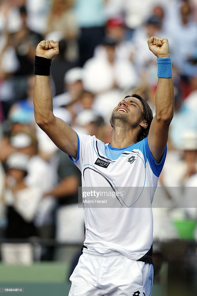 David Ferrer reacts after beating Tommy Haas, 4-6, 6-2, 6-3, in a men's semifinal match at the Sony Open tennis tournament at Crandon Park in Key Biscayne, Florida, Friday, March 29, 2013.