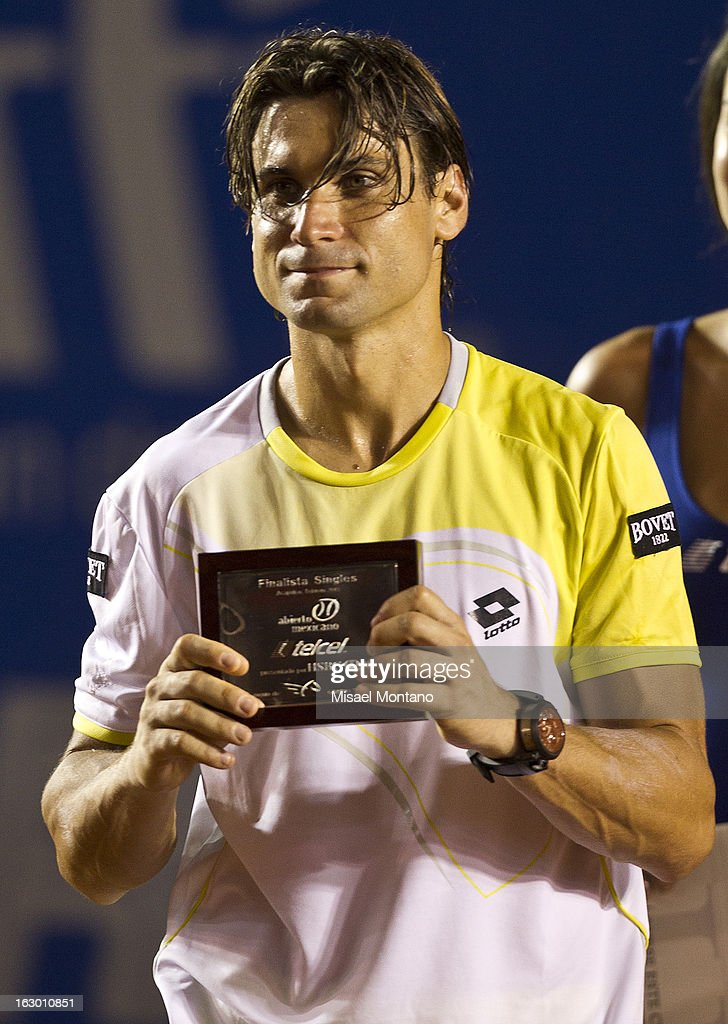 <a gi-track='captionPersonalityLinkClicked' href=/galleries/search?phrase=David+Ferrer&family=editorial&specificpeople=208197 ng-click='$event.stopPropagation()'>David Ferrer</a> shows his trophy after loosing the final round match against Rafael Nadal at the ATP Mexican Open Telcel on March 2, 2013 in Acapulco, Mexico.