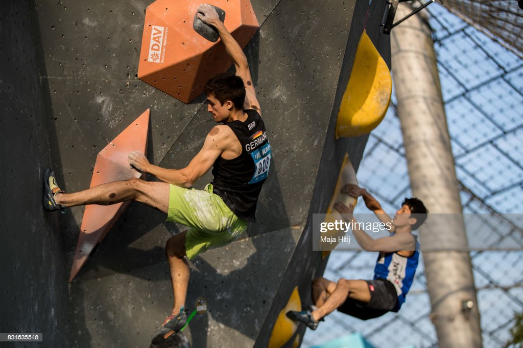 David Firnenburg of Germany (L) climbs during the qualification of IFSC Climbing World Cup in Munich on August 18, 2017 in Munich, Germany.